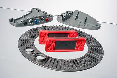 Gespritzte Bauteile (Bipolarplatte, Wärmetauscher-Ring und Batteriegehäuse) aus einem hochgefüllten Graphitcompound
