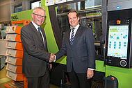 Rolf Saß (left), Managing Director of Engel Deutschland GmbH, hands over the all-electric injection moulding machine ENGEL e-motion 440 to Prof. Dr.-Ing. Christian Hopmann | photo: IKV/Fröls