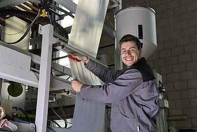 IKV pilot plant for extrusion: Student worker looks after the blown film unit