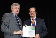 Prof. Christian Hopmann and Dr. Brian Grady during award ceremony in Detroit.