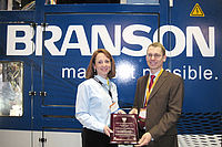 Dipl.-Ing. Mathias Weber (IKV) and Sophie Morneau (Branson) during the ceremony for the ANTEC Best Paper Award.